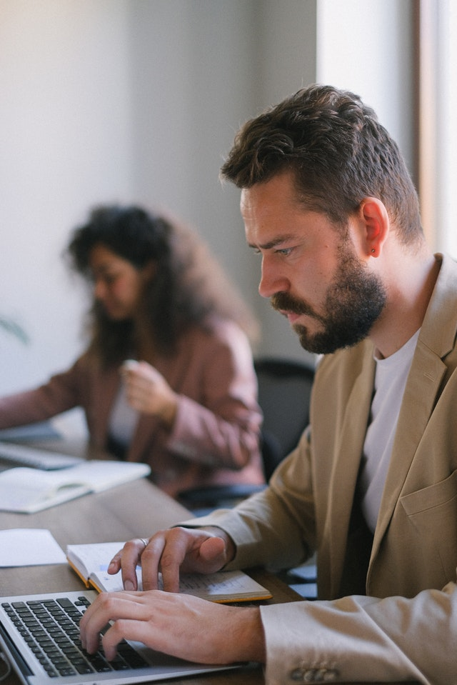 Concentrated man in office reading a guest post